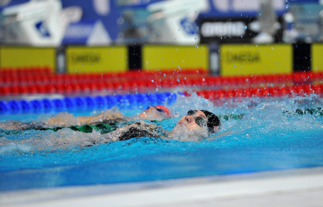 First Lt. Sara Holman, 50th Operations Support Squadron payload systems operator instructor, swims in the 200-meter backstroke at the 2015 International Swimming Federation swim championship Aug. 11, 2015, in Kazan, Russia. This year's FINA masters world championship competition was held in Kazan, commonly referred to as the sports capital of Russia. (Courtesy Photo)