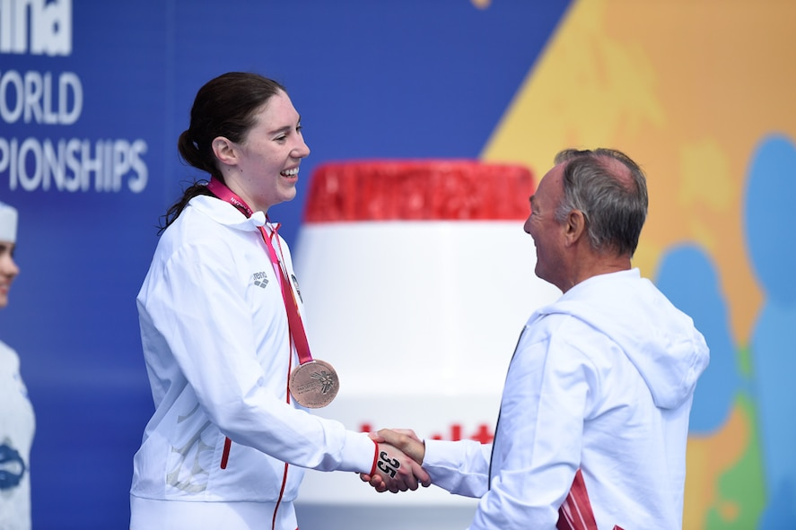 First Lt. Mary Holman, 50th Operations Group evaluator, receives the bronze medal for the 3,000-meter open water swim Aug. 7, 2015, in Kazan, Russia. Both Mary and Sara competed in the 2015 International Swimming Federation swim championship, earning a combined 12 top-10 finishes in seven events. (Courtesy Photo)
