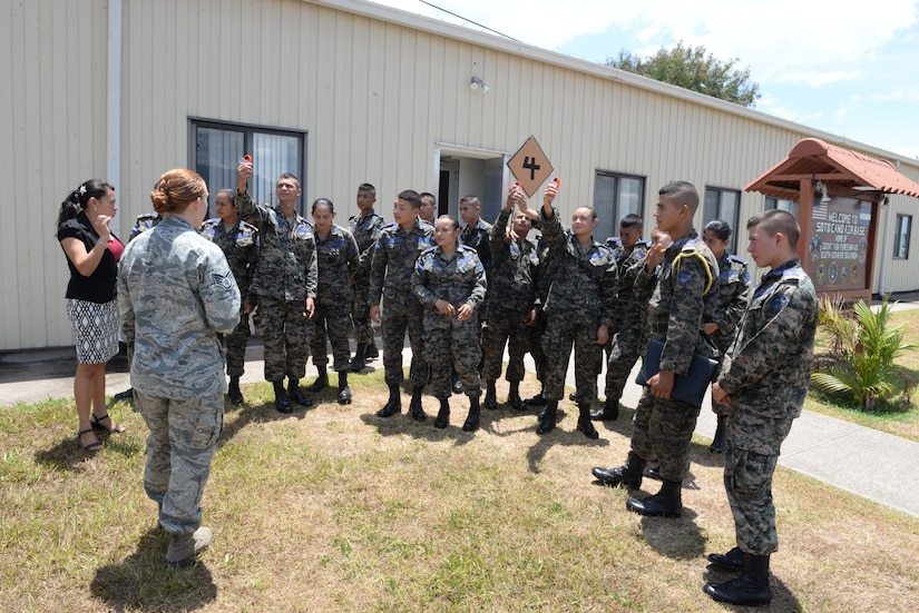 Staff Sgt. Alicia Freedman, a 612th Air Base Squadron weather forecaster, demonstrates the use of kestrels, hand-held weather meters, to members of the Honduran Air Force during Honduran Non-Commissioned Officer Day Sept. 1, 2015, at Soto Cano Air Base, Honduras. The event was organized to increase partnership capacity and teach the importance of camaraderie and teamwork between nations. (U.S. Air Force photo by Staff Sgt. Jessica Condit)