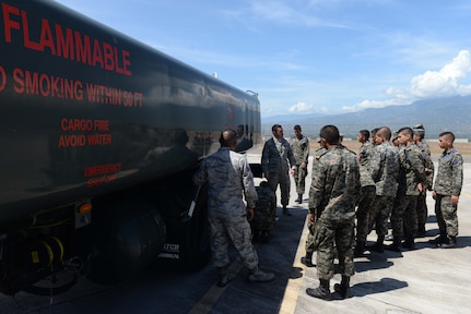 Senior Airman James Gomez, a 612th Air Base Squadron fuels technician, briefs Honduran Air Force service members during Honduran Non-Commissioned Officer Day Sept. 1, 2015, at Soto Cano Air Base, Honduras. The briefing was a stop at one of six locations where U.S. Air Force service members shared their knowledge with Honduran service members in order to encourage bi-lateral familiarity and build partnerships. (U.S. Air Force photo by Staff Sgt. Jessica Condit)