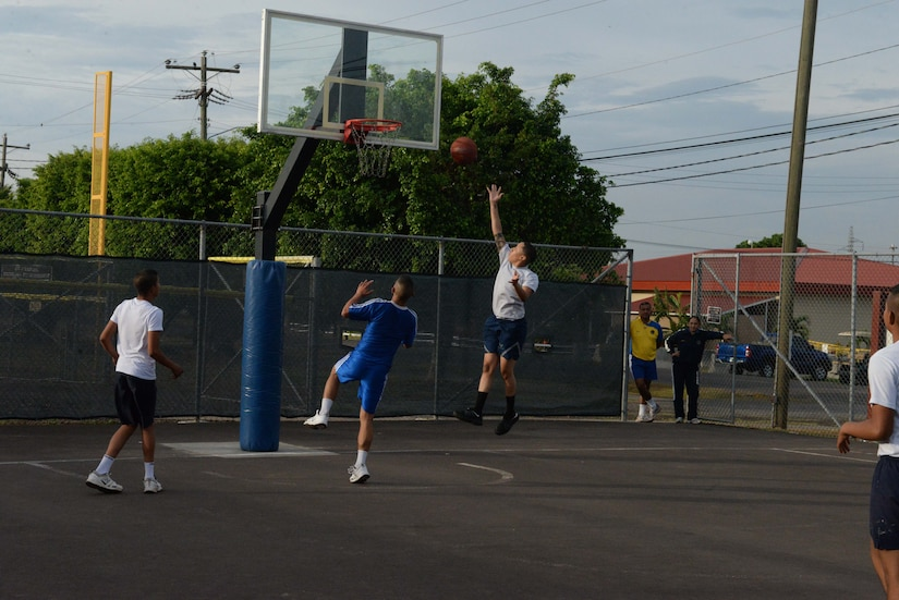 Service members from the Honduran and U.S. air forces participate in a game of basketball during Honduran Non-Commissioned Officer Day Sept. 1, 2015, at Soto Cano Air Base, Honduras. Throughout the day, service members representing both countries learned the importance of camaraderie and teamwork. (U.S. Air Force photo by Staff Sgt. Jessica Condit)