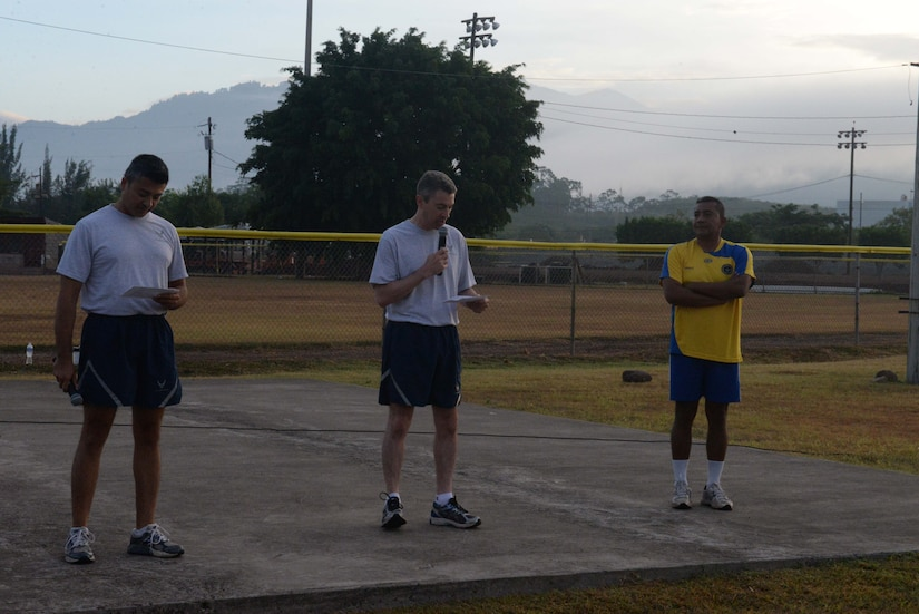 Lt. Col. James Wandmacher, 612th Air Base Squadron commander, kicks off Honduran Non-Commissioned Officer Day with a few words of encouragement for the Honduran and U.S. Air Forces, Sept. 1, 2015, at Soto Cano Air Base, Honduras. The day started with sporting events, teaching both air forces the lasting impact that camaraderie has on partnership and foreign relations. (U.S. Air Force photo by Staff Sgt. Jessica Condit)