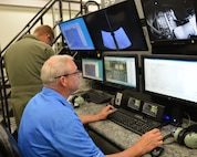 Nebraska Air National Guard boom operators hone their skills refueling aircraft in the newly acquired boom operator simulator located at the 155th Air Refueling Wing, Lincoln, Neb, Aug. 25. The Nebraska Air Guard is the first Guard unit to receive the BOSS 59-1495.