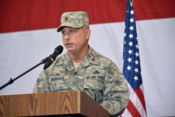 Maj. Christian Backhaus addresses the crowd for the first time after assuming command of the 552nd Aircraft Maintenance Squadron in a ceremony Monday in Bldg. 230, Dock 2. Major Backhaus replaces Lt. Col. Ronald Llantada, who recently took over as deputy commander for the 461st Maintenance Group at Robins Air Force Base, Ga. Major Backhaus previously served as commander of the 380th Expeditionary Maintenance Squadron at Al Dhafra Air Base, United Arab Emirates. Col. Andre Kennedy, 552nd Maintenance Group commander, presided over the ceremony attended by a host of family, friends and co-workers. (Air Force photo by Darren D. Heusel/Released)