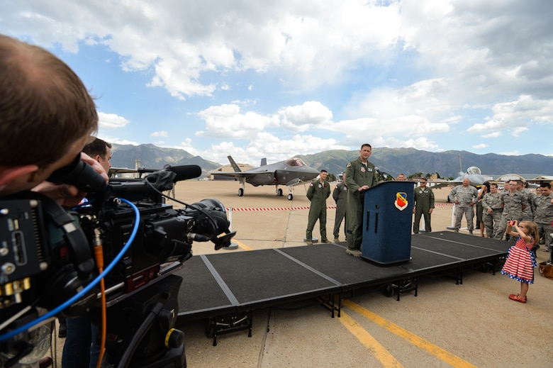 Col. David Lyons, 388th Fighter Wing commander, speaks to Airmen, family members, civic leaders and media after delivering an operational F-35A Lightning II aircraft to Hill Air Force Base, Utah, Sept. 2, 2015. Lyons, along with Lt. Col. Yosef Morris, 34th Fighter Squadron director of operations, delivered the first two jets, known as AF-77 and AF-78, at approximately 1 p.m. MDT after a 90-minute flight from the F-35 production facility in Fort Worth, Texas.  These aircraft are the first two of up to 72 jets that will be assigned to both the active-duty 388th and Reserve 419th Fighter Wings at Hill. (U.S. Air Force photo by Ron Bradshaw/Released)