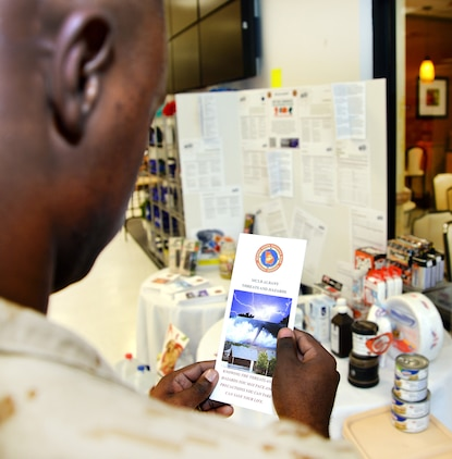 Sgt. Xzavier Thomas, Marine Corps Community Services, peruses an emergency preparedness flyer at a booth aboard Marine Corps Logistics Base Albany, recently. National Preparedness Month is underway and several static display booths will be set up at various locations including buildings 1221, 2200, 3500 and 3700. Information including how to prepare for severe weather and how to build an emergency kit as well as the installation mass notification system will be displayed at the booths.