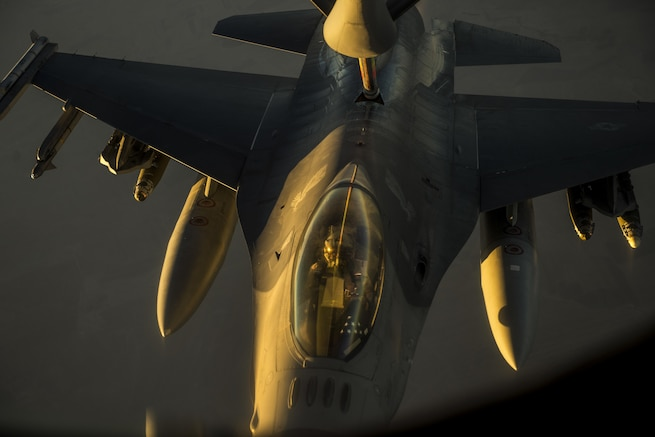 A U.S. Air Force F-16 Viper receives fuel from a KC-135R over Southwest Asia, Sept. 3, 2015. The KC-135R is assigned to the 340th Expeditionary Air Refueling Squadron. Coalition forces fly daily missions to support Operation Inherent Resolve. U.S. Air Force photo by Senior Airman Taylor Queen