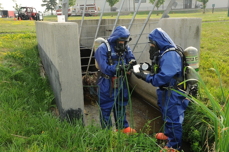 Members of the 914th Mission Support Group Fire Emergency Services inspect a water sample during a hazardous material and confined space exercise at the Niagara Falls Air Reserve Station on Sept. 3, 2015. The exercise showcased the capabilities and preparedness of the base's fire department. (U.S. Air Force photo by Staff Sgt. Matthew Burke)