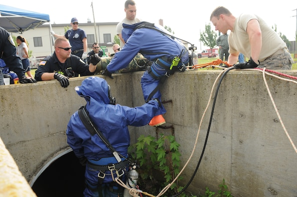 Members of the 914th Mission Support Group Fire Emergency Services prepare to enter a drain pipe during a hazardous material and confined space exercise at the Niagara Falls Air Reserve Station on Sept. 3, 2015. The exercise showcased the capabilities and preparedness of the base's fire department. (U.S. Air Force photo by Staff Sgt. Matthew Burke)