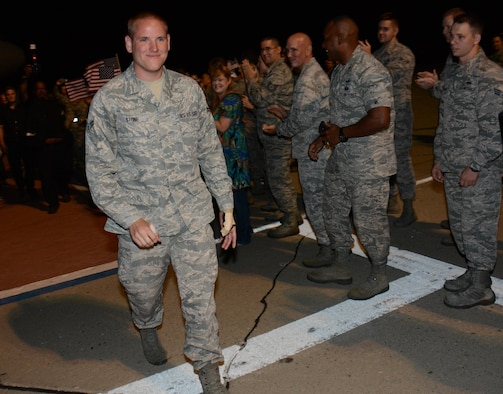 Airman 1st Class Spencer Stone, the Airman who helped foil a terrorist attack on a train in France Aug. 21, arrives at Travis Air Force Base, Calif., Sept. 3, 2015. Stone was greeted by hundreds of Airmen including Col. Joel Jackson, the 60th Air Mobility Wing commander, and Chief Master Sgt. Alan Boling, the 60th AMW command chief. He will receive continued medical treatment for his injuries at David Grant USAF Medical Center. (U.S. Air Force photo/Tech. Sgt. James Hodgman)