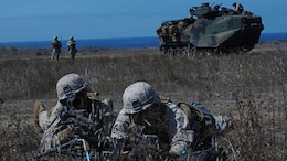 Marines with Alpha Company, 1st Battalion, 5th Marine Regiment provide security on the beach following an amphibious landing as part of Exercise Dawn Blitz 2015 at Marine Corps Base Camp Pendleton, Calif., Sept. 5, 2015. Dawn Blitz is a multinational, amphibious training exercise designed to hone the amphibious landing skills of I Marine Expeditionary Brigade, Expeditionary Strike Group Three and allies of the United States.