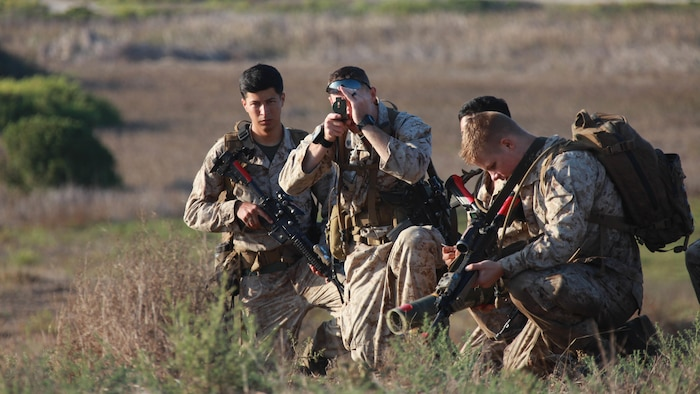 Marines with 1st Battalion, 5th Marine Regiment, 1st Marine Division use a compass to determine their left and right lateral limits on the beaches of Marine Corps Base Camp Pendleton, Calif., during Exercise Dawn Blitz 2015, Sept. 5, 2015. Dawn Blitz is a multinational training exercise designed to enhance Expeditionary Strike Group Three and 1st Marine Expeditionary Brigade's ability to conduct sea-based operations, amphibious landings, and command and control capabilities alongside Japan, Mexico and New Zealand.