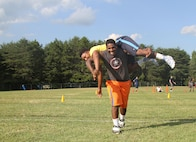 Justin Kidd, a high school senior and Bassett native, performs the fireman's carry during the maneuver-under-fire portion of the Marine Corps Combat Fitness Test, Aug. 27, 2015. The Bassett High School football team took part in the CFT in place of one of their normal practices, giving them a different workout than they are used to and challenging them in ways they've never been challenged. (U.S. Marine Corps photo by Sgt. Aaron Diamant/Released)