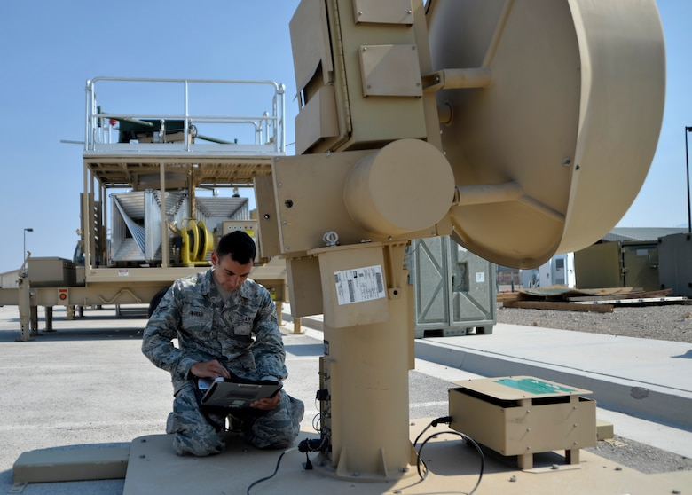 Airman 1st Class Stephen Parker, a 32nd Aircraft Communications Maintenance Squadron ground control station maintainer, powers a ground data terminal used to transmit signals needed to fly both the MQ-1B Predator and MQ-9 Reaper Aug. 19, 2015, at Creech Air Force Base, Nev. The ground data terminal is responsible for providing the line-of-sight flying capabilities of an RPA. (U.S. Air Force photo/Airman 1st Class Christian Clausen)