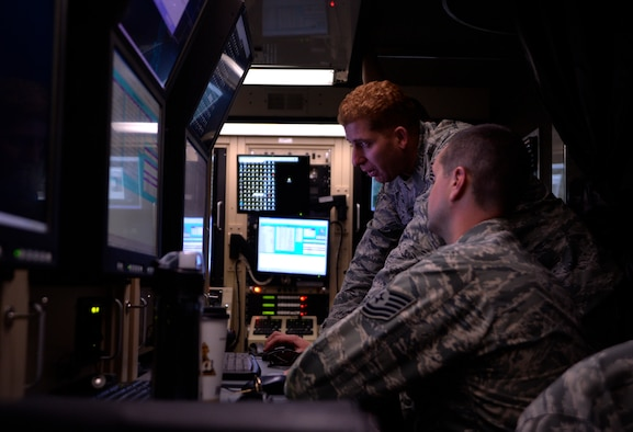 Tech. Sgt. Manuel Quiñones-Figuero, the 432nd Aircraft Communication Maintenance Squadron NCO in charge of formal training unit, teaches Tech. Sgt. Thomas Diest basic postflight procedures for the MQ-1B Predator and MQ-9 Reaper Aug. 19, 2015, at Creech Air Force Base, Nev. The 432nd ACMS is the only unit of its kind in the Air Force dedicated to maintaining the communications network for the RPA enterprise. (U.S. Air Force photo/Airman 1st Class Christian Clausen)
