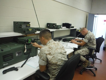 Students in the Aviation Communication Systems Technician Course are learning how to configure some of the radios used as a 5939, and establish communications between themselves and other Marines in the class