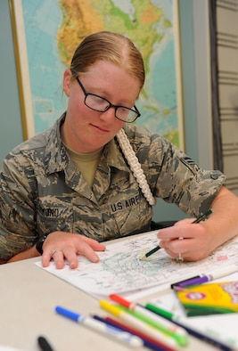 Airman 1st Class Kristen Ormond,  335th Training Squadron student, completes a synoptic scale analysis exam during the weather initial skills course Sept. 3, 2015, Keesler Air Force Base, Miss. Throughout the course, Airmen, Marines, Sailors and Coastguardsmen learn the foundations of weather forecasting with maps, radar and manual observation. (U.S. Air Force photo by Kemberly Groue)