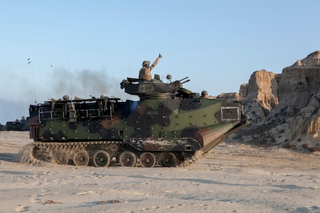 150905-N-MZ309-052 CAMP PENDLETON (Sept. 5, 2015) A Marine signals to move forward in an amphibious assault vehicle (AAV) during an amphibious landing for Exercise Dawn Blitz 2015. Dawn Blitz 2015 is a scenario-driven exercise designed to train the U.S. Navy and Marine Corps in operations expected of an amphibious task force while also building U.S. and coalition operational interoperability. (U.S. Navy photo by Mass Communication Specialist 2nd Class Ryan Riley/Released)