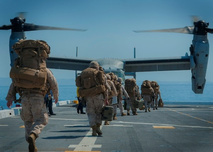 PACIFIC OCEAN (Sept. 5, 2015) – U.S. Marines assigned to 5th Marine Regiment Headquarters prepare to board an MV-22B Tilt-rotor Osprey assigned to Marine Medium Tilt-rotor Squadron (VMM) 163 with 3rd Marine Aircraft Wing during flight operations aboard amphibious transport dock ship USS Somerset (LPD 25) as part of Exercise Dawn Blitz 2015 (DB-15). Dawn Blitz 2015 is a scenario-driven exercise designed to train the U.S. Navy and Marine Corps in operations expected of an amphibious task force while also building U.S. and coalition operational interoperability. The exercise will test staffs in the planning and execution of amphibious operations in a series of live training events at sea and ashore. (U.S. Navy photo by Mass Communication Specialist 1st Class Vladimir Ramos/Released)