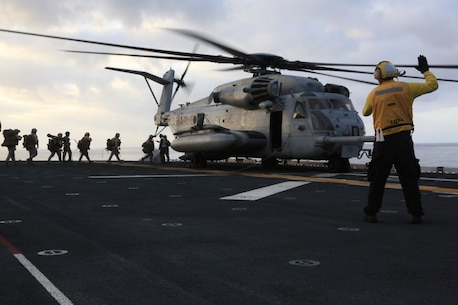 U.S. Marines with 5th Marine Regiment, 1st Marine Division board a CH-53E Super Stallion during Exercise Dawn Blitz, Sept. 5, 2015. Dawn Blitz 2015, a joint multinational amphibious exercise, promotes interoperability between the Navy, Marine Corps and Coalition partners. (U.S. Marine Corps photo by Lance Cpl. Eryn L. Edelman, 3D MAW Combat Camera/Released)