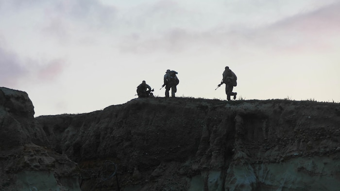 Marines with 1st Battalion, 5th Marine Regiment, 1st Marine Division run up a bluff to get in a blocking position with the rest of their platoon during Exercise Dawn Blitz 2015 at Marine Corps Base Camp Pendleton, Calif., Sept. 5, 2015. Dawn Blitz is a multinational training exercise designed to enhance Expeditionary Strike Group Three and 1st Marine Expeditionary Brigade's ability to conduct sea-based operations, amphibious landings, and command and control capabilities alongside Japan, Mexico and New Zealand.