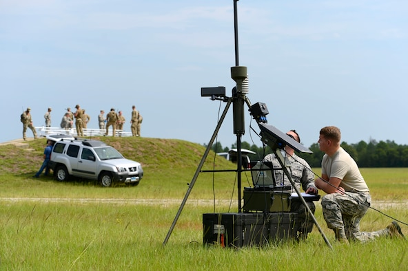 U.S. Air Force 1st Lt. Derek Romanyk, 20th Operations Support Squadron wing weather officer and Senior Airman Koletyn Jones, 20th OSS weather forecaster, take readings on a tactical weather sensor at Poinsett Electronic Combat Range, Wedgefield, S.C., Sept. 3, 2015. The weather is provided to joint terminal attack controllers approximately 10 minutes ahead of preparing coordinates to call in air strikes. (U.S. Air Force photo by Senior Airman Jensen Stidham/Released)