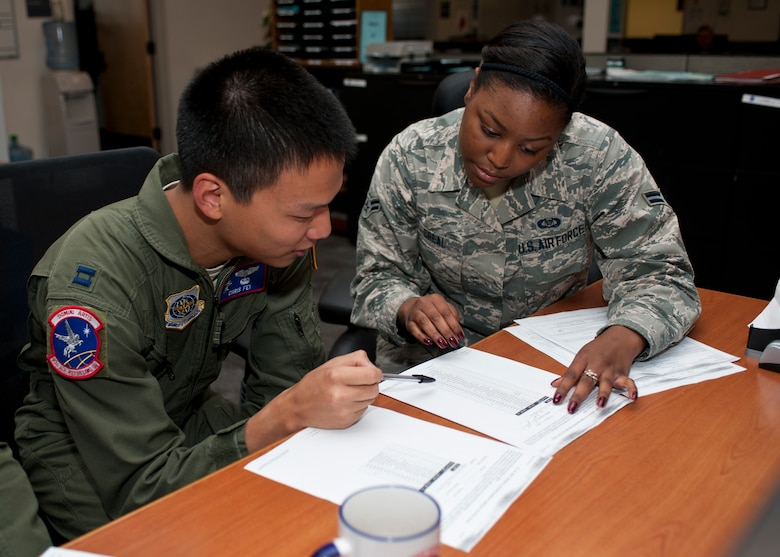 Airman 1st Class Joy Creal, 93rd Air Refueling Squadron aviation resource manager, goes over papers with Captain Chris Fei, 93rd ARS executive officer Sept. 3, 2015, at Fairchild Air, Force Base Wash. Creal keeps track of aircrew member training and ensures that aircrew are qualified to perform their duties. Her leadership selected her as one of Fairchild's Finest, a weekly recognition program that highlights top-performing Airmen. (U.S. Air Force photo/Airman Sean Campbell)