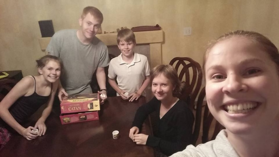 Darya (Dasha) Likhacheva (second from right) prepares to play Settlers of Catan with Lily (left), Greg, Nathan and Roze Sharp Thursday, Aug. 27, 2015, in the Sharp family dining room. Likhacheva came to the U.S. through a student exchange program and will be staying with the Sharps until the end of the school year. (Photo courtesy/Roze Sharp)