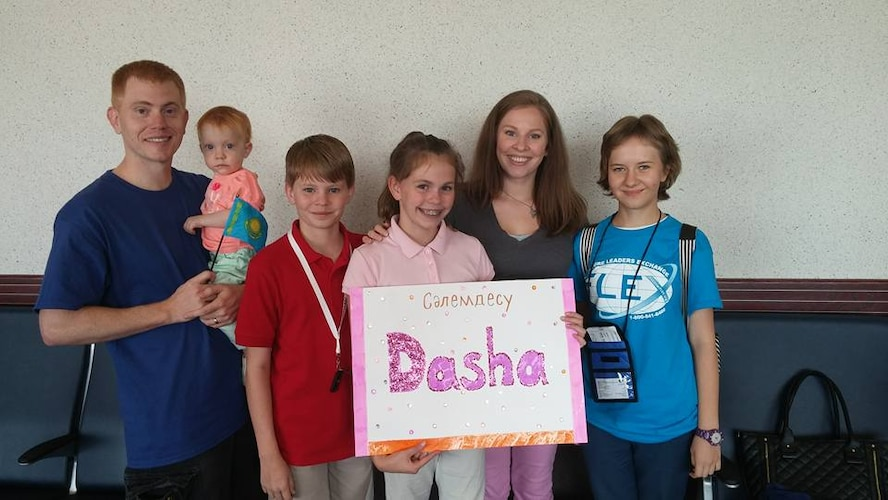 Greg (left), Aerobella, Nathan, Lily and Roze Sharp welcome Darya (Dasha) Likhacheva to America Thursday, Aug. 20, 2015, in the Colorado Springs Airport terminal. The Sharp family is hosting Likhacheva for the school year through the American Councils for International Education exchange program. (Photo courtesy/Roze Sharp)