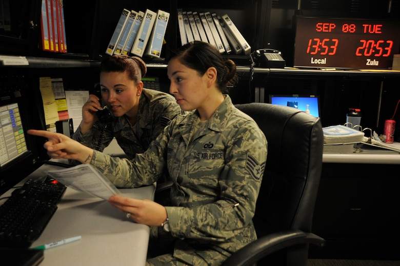 Staff Sgt. Danielle Horn, 30th Space Wing command post NCO in charge of reports (left) and Staff Sgt. Brittany Benberry, 30th SW command post NCOIC of training (right), prepare for the Combatant Command evaluation, Sep. 8, 2015, Vandenberg Air Force Base, Calif. The command post personnel work shifts around the clock, prepared at a moment's notice to contact the commander or relay information to or from higher headquarters. (U.S. Air Force photo by Airman 1st Class Robert Volio/Released)