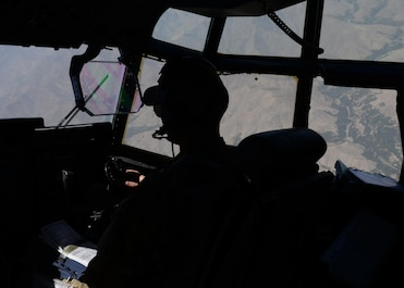U.S. Air Force Capt. Matt Buchholtz, 774th Expeditionary Airlift Squadron C-130 Super Hercules pilot, looks out the window of his aircraft while flying a medical evacuation mission Sep. 3, 2015, at Bagram Airfield, Afghanistan. Buchholtz and his team, who are deployed from Little Rock Air Force Base, Arkansas, fly various combat missions throughout Afghanistan supporting missions ranging from medical evacuations to cargo and passenger transports. (U.S. Air Force photo by Senior Airman Cierra Presentado/Released)