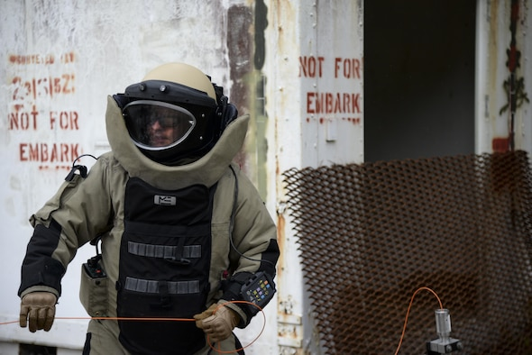 Staff Sgt. Alex Blair, an explosive ordnance disposal technician with the 11th Civil Engineer Squadron at Joint Base Andrews, Md., prepares to dispose of an improvised explosive device as part of Operation Llama Fury, Aug. 25, 2015, at Seymour Johnson Air Force Base, N.C. Blair and his team suited up and visually inspected the device before deciding the appropriate level of response to the threat. (U.S. Air Force photo/Senior Airman Brittain Crolley)
