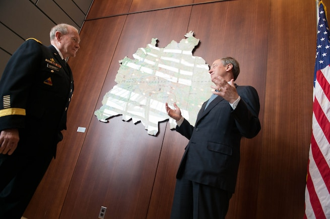 U.S. Army Gen. Martin E. Dempsey, left, chairman of the Joint Chiefs of Staff, meets with U.S. Ambassador to Germany John Emerson at the U.S. Embassy in Berlin, Sept. 9, 2015. DoD photo by D. Myles Cullen