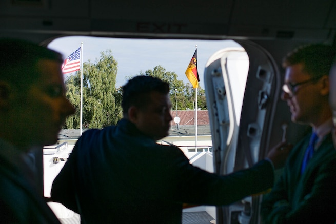 U.S. Air Force aircrew members open the door of a C-32 aircraft upon arriving in Berlin, Sept. 9, 2015. U.S. Army Gen. Martin E. Dempsey, chairman of the Joint Chiefs of Staff, traveled to Germany to meet with his German counterpart and discuss their nations' military-to-military relationships. DoD photo by D. Myles Cullen