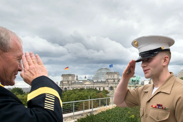 U.S. Army Gen. Martin E. Dempsey, chairman of the Joint Chiefs of Staff, returns a salute to a U.S. Marine Corps security guard at the U.S. Embassy in Berlin, Sept. 9, 2015. Dempsey is in Germany to meet with military leaders and discuss military-to-military relationships. DoD photo by D. Myles Cullen