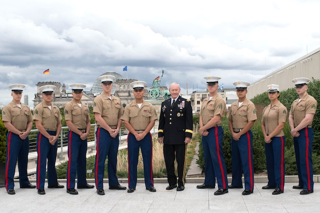 U.S. Army Gen. Martin E. Dempsey, chairman of the Joint Chiefs of Staff, stands for a photo with U.S. Marine Corps security personnel at the U.S. Embassy in Berlin, Sept. 9, 2015. DoD photo by D. Myles Cullen