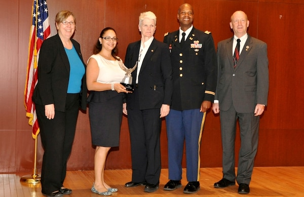 Earlier this year, Erica LaBeste (second from left), chief of the Real Estate and Real Property Support Branch for the U.S. Army Corps of Engineers, New York District, was recognized by the New York City Federal Executive Board for staff development initiatives. Above, Erica with Real Estate Chief Noreen Dresser (center), Lt. Col. John Knight (second from right), and members of the Federal Executive Board.