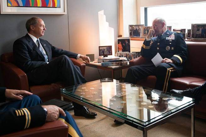 U.S. Army Gen. Martin E. Dempsey, right, chairman of the Joint Chiefs of Staff, meets with U.S. Ambassador to Germany John Emerson at the U.S. Embassy in Berlin, Sept. 9, 2015. DoD photo by D. Myles Cullen