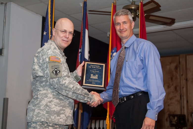 Little Rock District Commander Col. Courtney W. Paul presents Craig Evans with the district's Engineer of the Year plaque during an awards ceremony.
