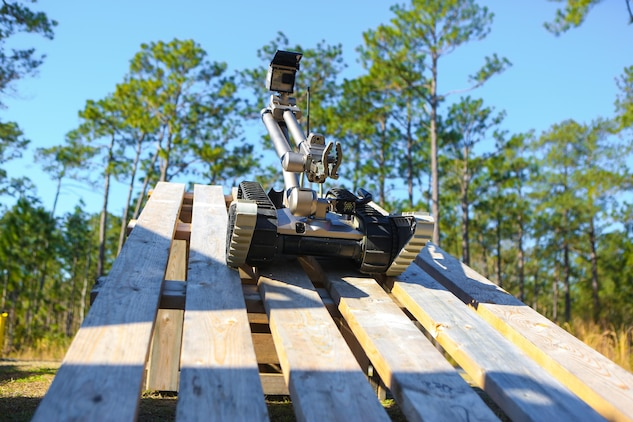 An R2C Robot, operated by a Marine with 2nd Combat Engineer Battalion, 2nd Marine Division, drives down an obstacle during a training exercise aboard Marine Corps Base Camp Lejeune, N.C., March 11, 2014. Marine Corps Systems Command will demonstrate capabilities of several robots Marines use in the field during Marine Week Phoenix Sept. 10-13.