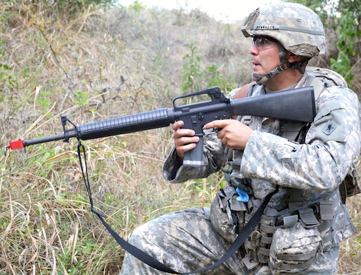 First Sgt. Robert Brannock, Academy Brigade, U.S. Army Medical Department Center and School, U.S. Army Health Readiness Center of Excellence, reacts to enemy gun fire at the warrior task and battle drills lanes during the 2015 AMEDDC&S, HRCoE Best Medic competition at Camp Bullis Sept. 2.