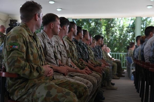 Participants listen as a Larrakia Aboriginal Nation elder Bilawarra Lee speaks Aug. 29 at Larrakeyah Barracks, Darwin, Northern Territory, Australia, before the start of Exercise Kowari 15. Kowari is a trilateral environmental survival training opportunity hosted by Australia and includes forces from Australia, China and the U.S. simultaneously. Environmental survival training in the Australian Outback offers a unique training opportunity in the Pacific.