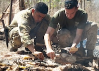 Australian Army LCPL Michael Dela Pena, left, and U.S. Marine Corps Lance Cpl. Tylor Lea with 1st Battalion, 4th Marine Regiment, Marine Rotational Force - Darwin, a Eugene, Oregon native, gather crocodile meat during Exercise Kowari 15 Sept. 4 in the Daly River region, Northern Territory, Australia. Kowari is a trilateral environmental survival training opportunity hosted by Australia and includes forces from Australia, China and the U.S. simultaneously.