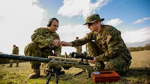 Sergeant Tanner Grace, a native of Troy, Pennsylvania, and an armorer for the Marine Corps Shooting Team, and Australian Army Pvt. Gareth Mulraney, an armorer for the Australian Army Skill at Arms Meeting 2015, work on the next-generation M40 sniper rifle during sniper rifle snap-in match May 10 at the Puckapunyal Military Area, Victoria, Australia, during the AASAM 2015. Grace was only international armorer supporting AASAM, an annual, international combat-marksmanship competition hosted by the Australian Army, May 6 to 22. During the competition, Grace and Mulraney were the only armorers working on other nation's service pistols, rifles, sniper rifles and machine guns. The AASAM competition afforded an unprecedented combined training opportunity and improved interoperability with Australian Defense Forces and other militaries present at AASAM 2015.