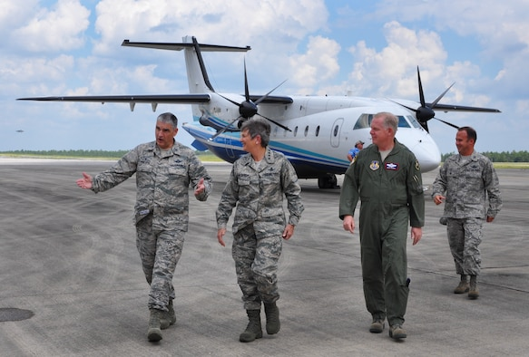 Col. James Phillips, 919th Special Operations Wing commander, welcomes Gen. Ellen M. Pawlikowski, Air Force Materiel Command commander, to Duke Field, Fla., Sept. 9. Pawlikowski visited the Reserve base with Maj. Gen. David Harris, the Air Force Test Center Commander (pictured), during her tour of Eglin Air Force Base. She also met with the wing's combat aviation advisers and flew in the special operations aircraft, C-146 Wolfhound.  (U.S. Air Force photo/Dan Neely)
