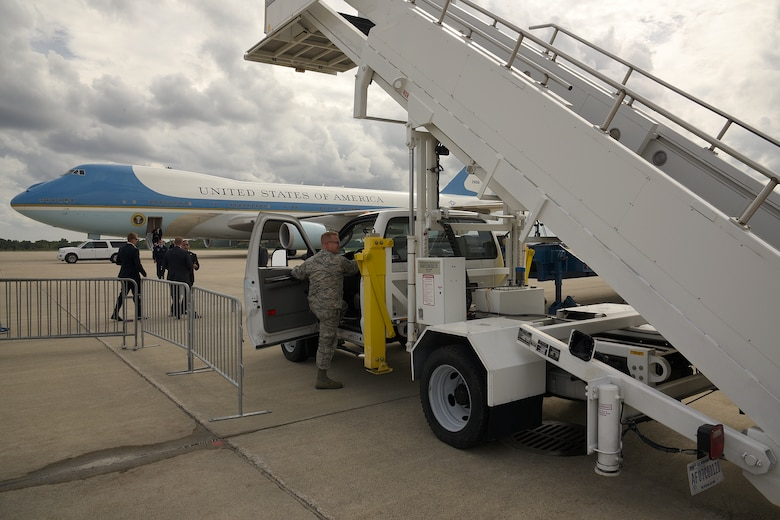 Staff Sgt. Bryan Russell prepares to drive out the air stairs to Air Force One during a visit by President Barack Obama to Selfridge Air National Guard Base, Mich., Sept. 9, 2015. Russell is a member of the 127th Wing, Michigan Air National Guard. President Barack Obama stopped at the base during a trip to nearby Macomb Community College in Warren, Mich., to discuss federal higher education initiatives. (U.S. Air National Guard photo by Master Sgt. David Kujawa / Released)