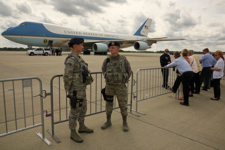 Senior Airman Lisa Duval and Airman 1st Class Xavier Lopez, both members of the 127th Wing Security Forces Squadron, provide security for Air Force One at Selfridge Air National Guard Base, Sept. 9, 2015. President Barack Obama stopped at the base during a trip to nearby Macomb Community College in Warren, Mich., to discuss federal higher education initiatives. (U.S. Air National Guard photo by Master Sgt. David Kujawa / Released)