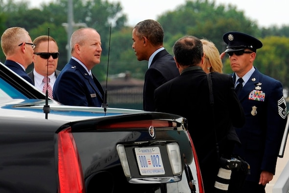 President Barack Obama is greeted by Brig. Gen. Doug Slocum, commander of the 127th Wing, upon the president's arrival at Selfridge Air National Guard Base, Mich., Sept. 9, 2015. The president spoke briefly with the general and visited with a small group of Airmen and local guests at the base before traveling to nearby Macomb Community College in Warren, Mich., to discuss federal higher education initiatives. (U.S. Air National Guard photo by Tech. Sgt. Dan Heaton / Released)