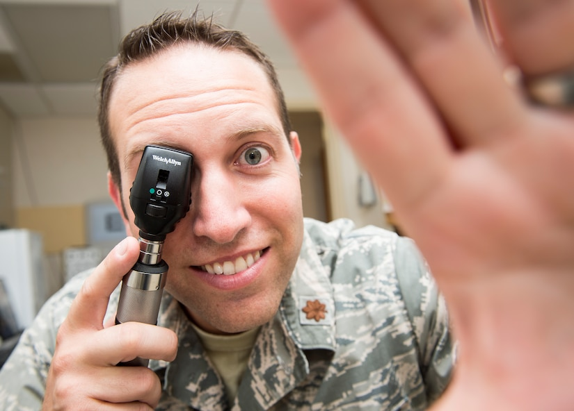 Maj. Peter Carra, 628th Medical Group optometry flight commander poses for a photo Sep. 9, 2015, at the optometry office on Joint Base Charleston, S.C. The optometry clinic provides services such as eye examinations, visual acuity checks, repairing glasses, color vision tests and comprehensive exams. To set up an appointment, call the Air Base optometry clinic at 963-6880. (U.S. Air Force photo/Airman 1st Class Clayton Cupit)