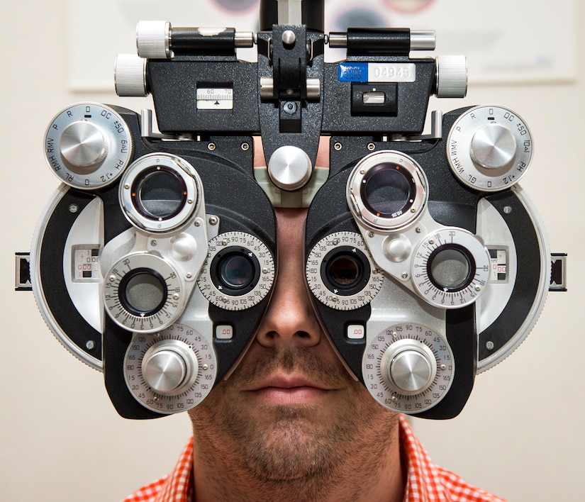 Jason Hale, 628th Medical Group ophthalmic technician poses for a photo Sep. 9, 2015, at the optometry office on Joint Base Charleston, S.C. The optometry clinic provides services such as eye examinations, visual acuity checks, repairing glasses, color vision tests and comprehensive exams. To set up an appointment, call the Air Base optometry clinic at 963-6880. (U.S. Air Force photo/Airman 1st Class Clayton Cupit)